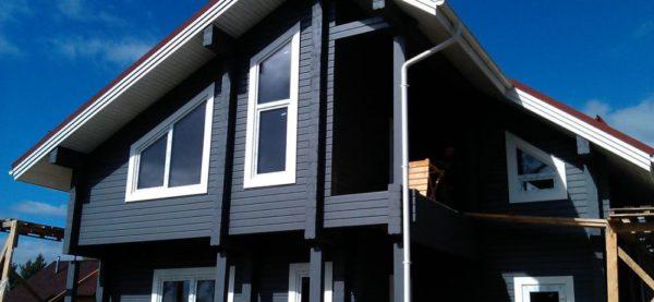 Покрасить деревянный дом